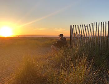 Couple enjoying the sunset together at Seabrook