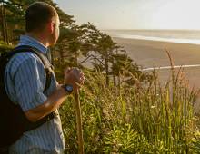 Man stops to enjoy the scenery while hiking at Seabrook